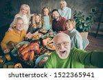 Photo Of Big Family Sit Huggin...