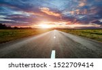 Empty Road With Sunrise And...
