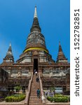 Small photo of Ayutthaya, Thailand - 12 July 2017: The big Chedi of Wat Yai Chai Mongkhon, built by King U-thong in 1357 A.D. to accommodate the monks that were ordained by Phra Wanratana Mahathera Burean.