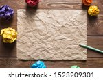 Crumpled Brown Paper Sheet And...