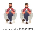 man sits in a chair and holds a ... | Shutterstock .eps vector #1523309771
