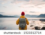 Back View Of Male Tourist With...