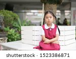 Small photo of Asian child cute or kid girl and student big eye with shorten mouth or pucker up with happy cheerful and wear school uniform for education and back to school or go to school at kindergarten or nursery