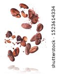 Small photo of Cocoa beans flying in the air. Cracked cocoa beans levitate on white background. High resolution image. Levitation concept.