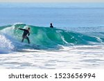 Surfer Racing The Curl On A...
