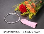 Small photo of Bouquet wrapped in cellophane and rosary