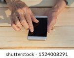 hands of an elderly man holding ... | Shutterstock . vector #1524008291