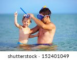happy father and son snorkeling | Shutterstock . vector #152401049