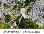 Small photo of View of the medieval fort Mirabela built on a cliff. Omis. Croatia.