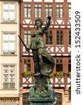 Frontal view of the Justice statue in Frankfurt with ancient palaces in background - stock photo