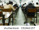 Students Sitting In An Exam...