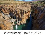 Steep Walls Of Red Sandstone A...