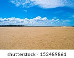 Great sand beach with blue sky during tide in the Bretagne in France - stock photo