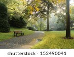 Bench In A Park On A Sunny...