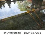 Stock photo wooden water dipper in japan shinto shrine it s prepare for cleaning before praying vintage tone 1524937211