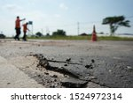 Repairing A Damaged Road For...