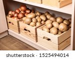 crates with potatoes and onions ...