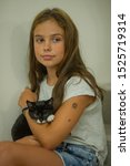 Stock photo pretty young caucasian girl with cute kitten teenager girl with a wary kitten a child and a cat 1525719314