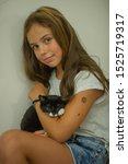 Stock photo pretty young caucasian girl with cute kitten teenager girl with a wary kitten a child and a cat 1525719317