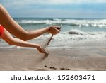girl playing with sand on the...   Shutterstock . vector #152603471