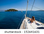 young woman sailing on yacht in ... | Shutterstock . vector #152641631