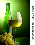 a glass and a bottle and green grape - stock photo