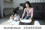 Small photo of Holiday concept. The daughter is helping her mother fold the clo