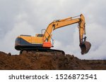 Small photo of Work of special equipment at a construction site. Crawler excavator performs earthwork.