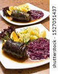 Small photo of Beef roulade with red cabbage and boiled potatoes