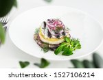 Stock photo appetizer food salted herring butter and red onion on white plate selective focus horizontal 1527106214