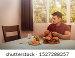 Small photo of Concepts, problems, and disunity in the family : One young man sat for lunch alone, watching the empty chair without his wife who had eaten together because of family problems