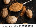 Nutmegs And Ground Nutmeg On A...