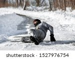 Small photo of Injured man lying on the road, downfall and accident on winter season, black ice