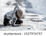Small photo of Woman has an accident cause of black ice on the road, downfall and injury, copyspace