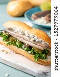 Stock photo traditional dutch snack seafood sandwich with herring onions and pickled cucumber broodje haring 1527979064