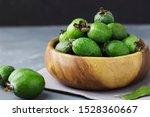 Green Feijoa Fruits In A Wooden ...