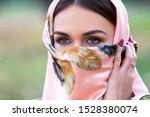 beautiful arabian woman covers... | Shutterstock . vector #1528380074