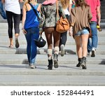 Young people walking up the stairs - stock photo