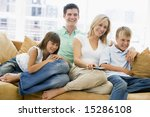 family sitting in living room... | Shutterstock . vector #15286108