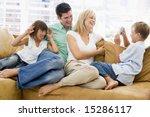 family sitting in living room...   Shutterstock . vector #15286117