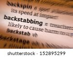 Small photo of Backstabbing - the action or practice of criticizing someone in a treacherous manner while feigning friendship.