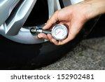 hand holding pressure gauge for ... | Shutterstock . vector #152902481