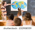 young teacher with his class at ... | Shutterstock . vector #152908559