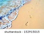 Foot Prints In Beach