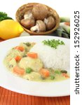 Small photo of Chicken fricassee with rice, capers and parsley on a light background