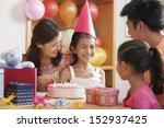 family celebrating girl's... | Shutterstock . vector #152937425