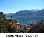 A monastary over a lake in the mountains. - stock photo