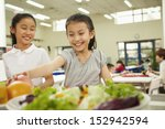 Stock photo students reaching for healthy food in school cafeteria 152942594