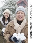 Couple Holding Snow Balls In...