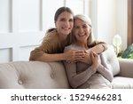 Loving Adult 30s Daughter Hug...